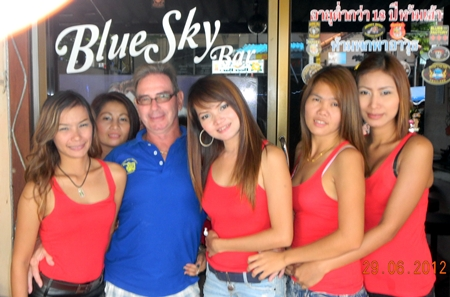 Andy Oz celebrates his win with the staff at the Blue Sky Bar.