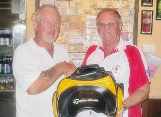 Barry Elphick, left, receives the MBMG golfer of the month prize from Derek Brook.