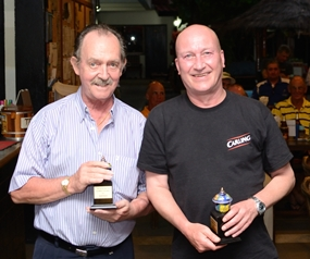 Stephen Beard, left, and Barry Winton, right, from the winning team, pose with their trophies.