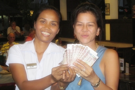 A happy Bling, left, – the 50/50 draw winner.