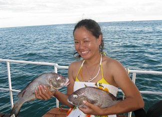 Kamping holds her prize catch.