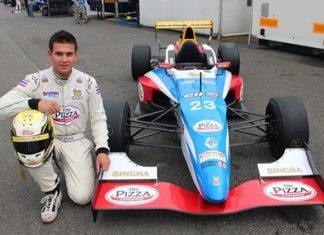 Sandy Stuvik poses next to his Formula Renault racecar at the Oschersleben Circuit in Germany.