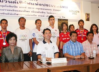 Pattaya Mayor Ittipol Kunplome, President of Thailand Windsurf Association, and Sonthaya Khunplome, President of Chonburi Sports Association, seated center, chair the welcoming committee for the successful Thai windsurfers, standing rear.