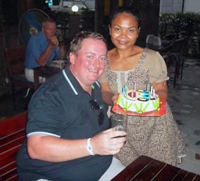 Mark is seen receiving his birthday cake.