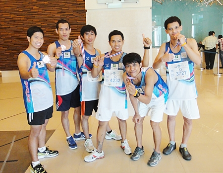 Staff and guests of the Holiday Inn Pattaya proudly show off their medals that they received for their participation in the Pattaya King's Cup Marathon recently. The word is that they all completed the quarter marathon in record time.
