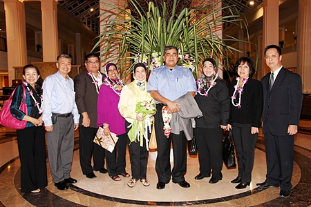 Neoh Kean Boon (right), Resident Manager of Dusit Thani Pattaya is seen welcoming Tan Sri Dato' Sri Khalid Bin Abu Bakar (fourth from right), deputy inspector-general of Royal Malaysia Police and Pol. Gen. Suwat Chanitthikul (second from left), deputy commissioner general of the Royal Thai Police and other officials who came to Pattaya for the annual gathering of top brass police officers in the spirit of cooperation and camaraderie. The two countries alternately host the annual get together and this year, it was Thailand's turn to welcome them and challenge the visitors to a friendly game of rugby.