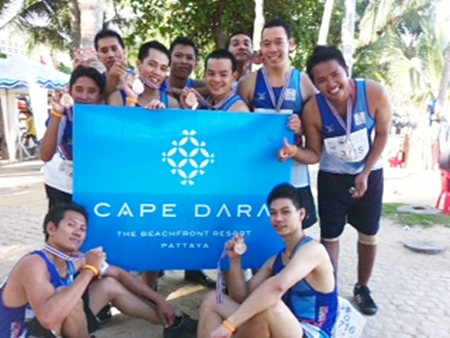 The Cape Dara Resort Pattaya runners celebrate at the end of the King's Cup Pattaya Marathon 2012 held at the world renowned resort recently