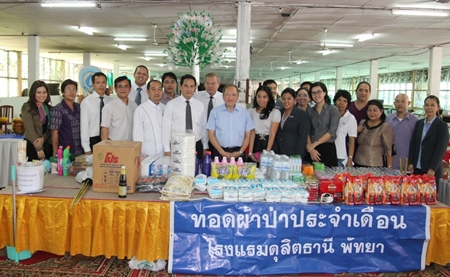 Staff and management of Dusit Thani Pattaya, led by GM Chatchawal Supachayanont (centre), made merit at the Jittapawan Temple recently to deliver donations of cash and other items for the community. The occasion was also held to donate candles to mark one of the holiest days in Buddhism, 'Asalaha Bucha Day' on August 2. The temple visit is done every month as part of the hotel's CSR initiatives that also include fund-raising to help poor villagers in the north.