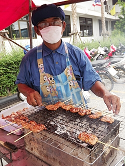 Almost ruined by last year's devastating floods, Sorn Pongkhan found a lifeline selling pork on a stick.