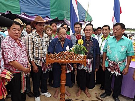 Nongprue Mayor Mai Chaiyanit (center) talks about the history of buffalo races.