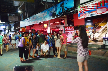 Visitors still wander through Walking Street even though all bars and entertainment venues are closed on Khao Pansaa.