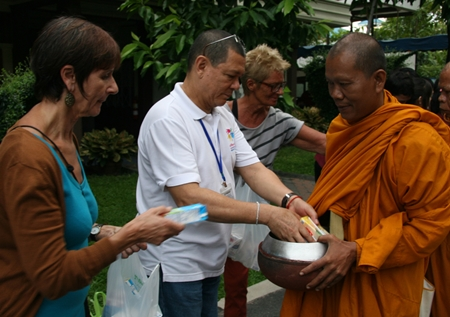 Foreign volunteers make merit on Father Ray Day.
