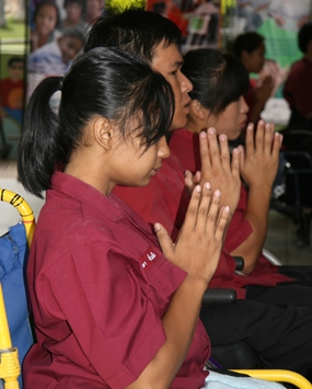 Students of the Father Ray Foundation join the monks in prayer.