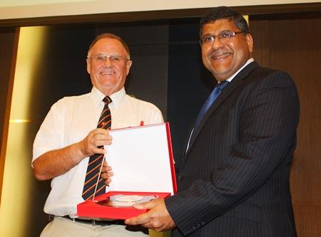 Representing the Royal British Legion, Derek Brook presents a plaque of appreciation to HE Asif Ahmad, British Ambassador to Thailand.