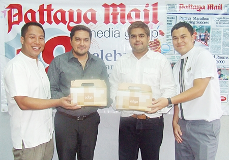 Dhaninrat (Sunday) Klinhom (left), Marketing Communications Manager for Hilton Pattaya and Thanagon Poungbpchart, Assistant Marketing Communications Manager for Hilton Pattaya (right) congratulate Pattaya Mail's Kamolthep and Tony Malhotra.