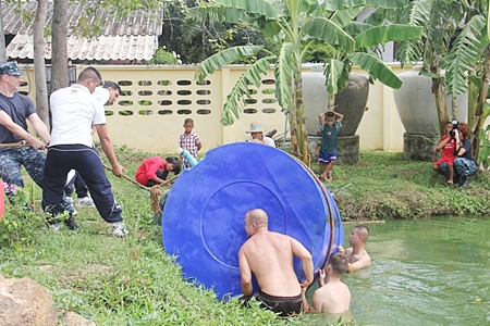Thanks to the Thai and US navies, they were able to drain the tank and remove it from the pond.