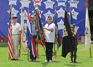 Color Guard at present arms during ID4's opening ceremony in Bangkok. Left to Right: Rad Mays, Jim Coomes, Rick Reece and Young Marines PFC Bret Mays.