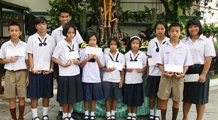 Ten local children received scholarships.