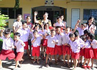 Radchada Chomjinda and 20 children from the HHN's Pattaya Orphanage say thanks to Pattaya Mail.