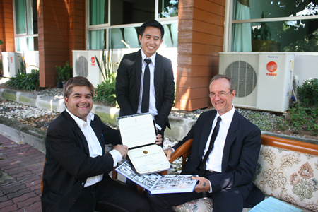Recent graduate Rienchai shows off his accomplishments to Tony and Woody.
