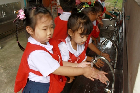Youngsters at the Ya Pa Yub Child Development Center Khet Udomsak are taught how to thoroughly wash their hands.