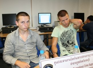 Lithuanian students Marius Giedriunas and Dangis Valkauskas have been arrested in possession of 30 counterfeit ATM cards, $460 cash, two black caps and a plastic mask.