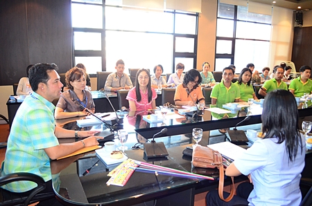 Mayor Itthiphol Kunplome meets with health and AIDS social workers at City Hall.