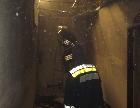 Firefighters work to extinguish the blaze at the Thai Saisiam Massage Center.