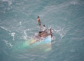 The tip of the bow is all that's visible of the sunken vessel.