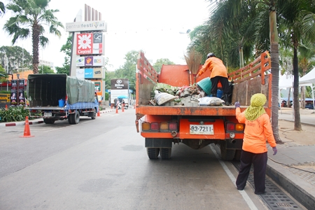 City workers clean up the usual mess left behind by still another big event on Beach Road.