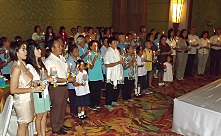 Guests at the party sing a candlelight song to honor HM the Queen and all mothers for Mother's Day.