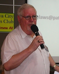 Board Member Darrel Vaught discusses recent revisions of the website with PCEC members and guests.