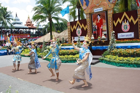 Professional dancers perform Thai classical dance during the celebration.