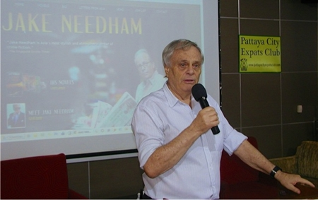 Fellow author Desmond Bishop introduces renowned writer Jake Needham to the August 12th meeting of Pattaya City Expats Club.