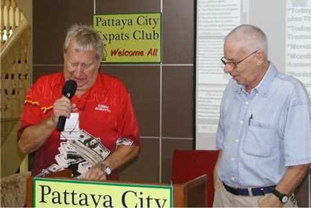 'Hawaii Bob' Sutterfield announces the draw for the Frugal Freddies gift vouchers for the week, at some of Pattaya's great value for money restaurants. MC Richard Silverberg looks on.
