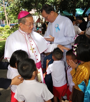 Bishop Emeritus Thienchai Samanjit spreads his loving care amongst the children.
