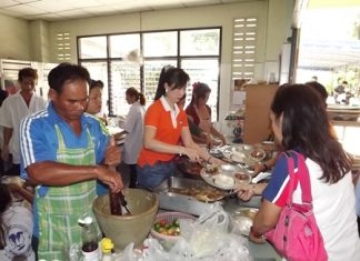 YWCA and Issan Association members are hard at work in the kitchen, stirring up a lunch for the Redemptorist Vocational School.