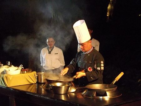 Renowned chef, Peter Lai, displays his cooking skills during the grand opening.