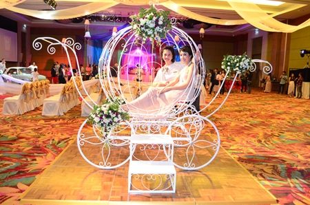 This carriage won't turn into a pumpkin at midnight, as it is one of the elaborate props available for a special wedding package.