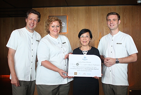 (From left) Hilton Hotel Pattaya's Michel Scheffers (Director of Operations), Peta Ruiter (Director of Business Development) and Food and Beverage Manager Simon Bender (right), present the prize to Radchada Chomjinda (2nd right), head of the Human Help Network Thailand.