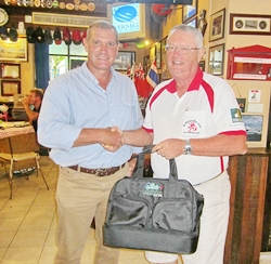 Simon presents the monthly prize to Dick Warberg.