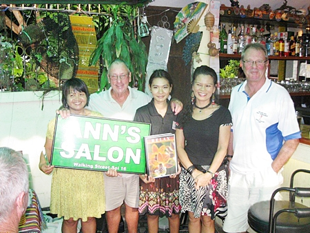 Tuesday's winners pose with Ann from Ann's Salon and the staff of The Relax Bar.