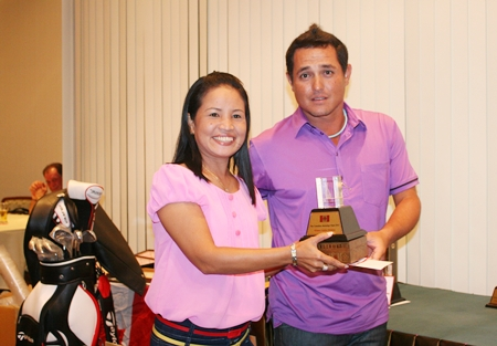 Ladies winner Janthorn Kuanha receives her trophy.