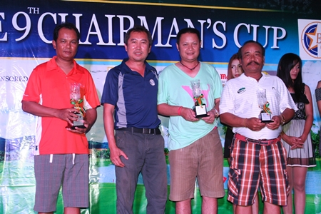 Prizes winners accept their trophies from Pravit Rossawatsuk, Asst. GM of Eastern Star Country Club & Resort, standing 2nd left.