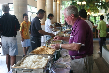 Players get stuck into the delicious buffet.