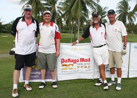 The Pattaya Mail team pose for a photo.