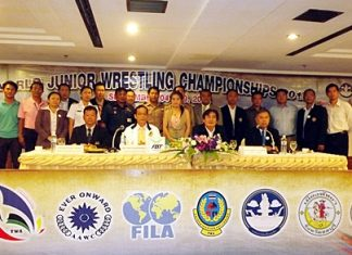 Pattaya City officials, led by deputy mayor Ronakit Ekasingh, and administrators of the Thailand Wrestling Association (TWA) pose for a photo at a press conference held August 9 at the Ambassador City Hotel, to announce the upcoming World Youth Wrestling Championships.