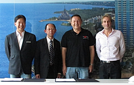From left:  Birathon Kasemsri Na Ayudhaya (Partner), Sommai Ungsrithong (SCB Commercial Banking), Rony Fineman and Winston Gale (Partners/Developers) pose for a photo at a signing ceremony held, August 17, to complete the finance agreement for construction of The Palm luxury development at Wongamat Beach.
