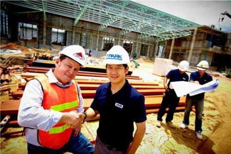 Russell Pang, Country Business Development Director of CEVA Logistics (Thailand) Limited (CEVA), left, and Patan Somburanasin, General Manager of TICON Logistics Park Co., Ltd (TPARK), inspect progress at the construction site of CEVA Logistics new facility in Laemchabang.