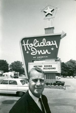 This undated photo shows company founder Kemmons Wilson standing outside the first Holiday Inn in Memphis, Tess.